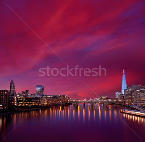 London skyline sunset on Thames river Stock photo © lunamarina