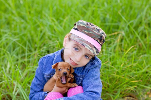 little girl with pet puppy mascot mini pinscher Stock photo © lunamarina