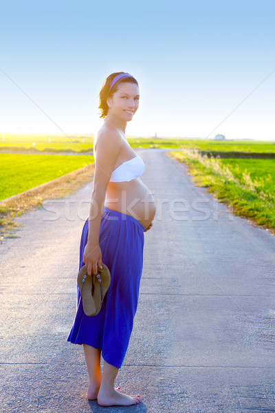 Beautiful pregnant woman walking on track outdoors Stock photo © lunamarina