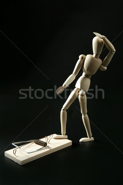 Wooden mannequin with mouse trap, black background Stock photo © lunamarina