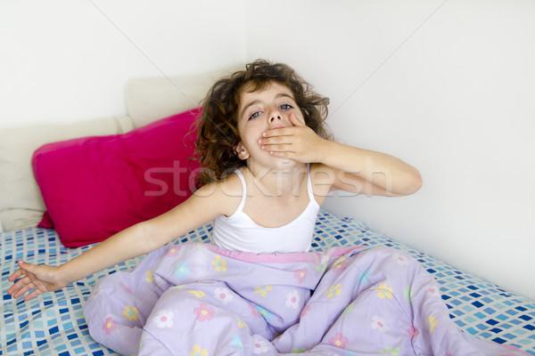 awakening girl yawning bed messy morning hair Stock photo © lunamarina