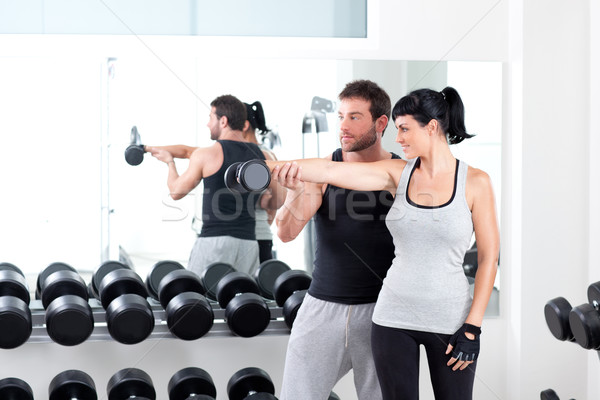 Stock photo: gym woman personal trainer with weight training