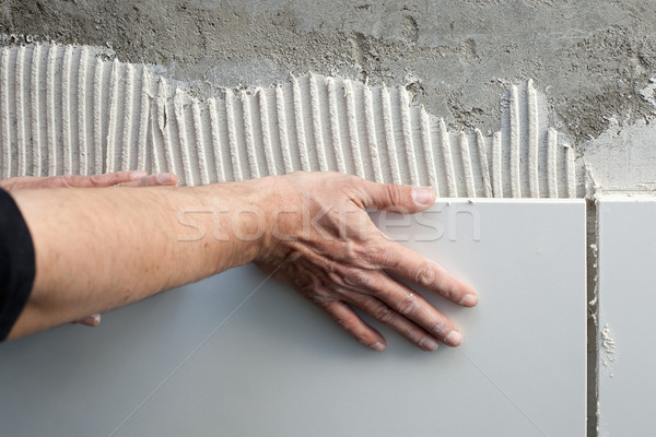 construction mason man hands on tiles work Stock photo © lunamarina
