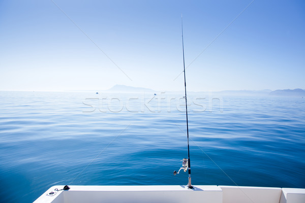 boat fishing rod in mediterranean blue sea Stock photo © lunamarina