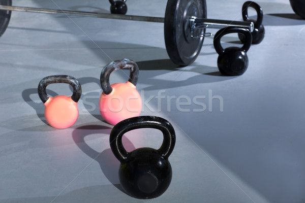 Kettlebells at crossfit gym with lifting bar Stock photo © lunamarina
