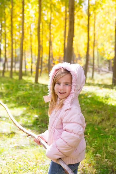 Explorer girl with stick in poplar yellow autumn forest Stock photo © lunamarina