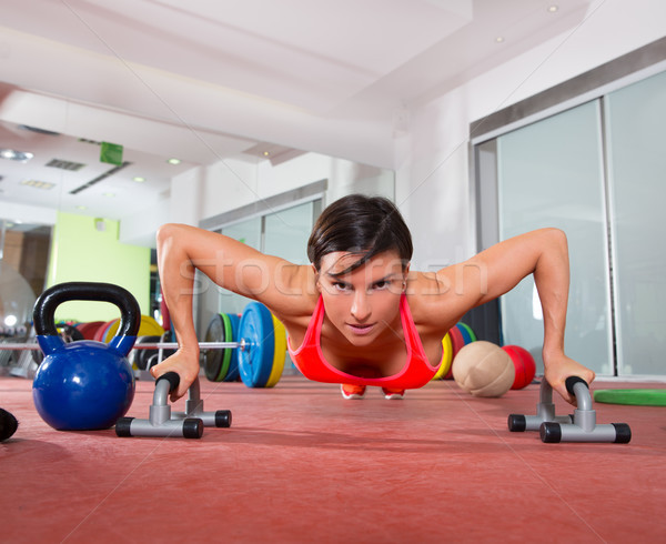 Crossfit fitness woman push ups pushup exercise Stock photo © lunamarina