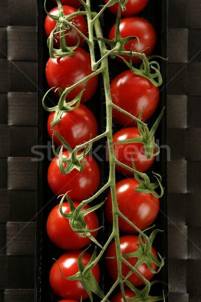 Piros paradicsomok ág UN fekete műanyag Stock fotó © lunamarina