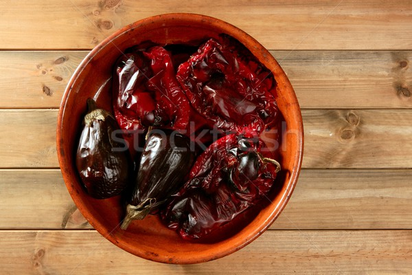 Eggplant and peppers roasted on clay vessel Stock photo © lunamarina