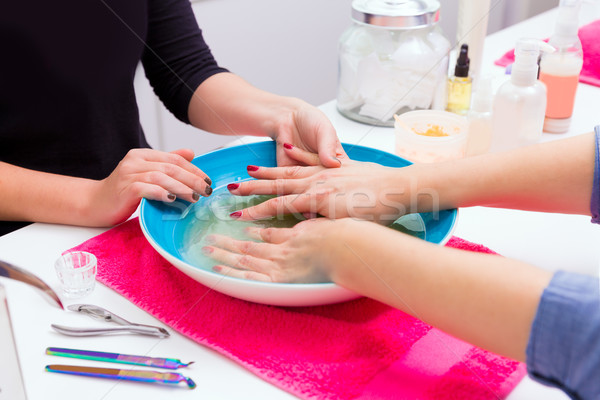 Nail saloon scrub bath exfoliant hands in bowl water Stock photo © lunamarina