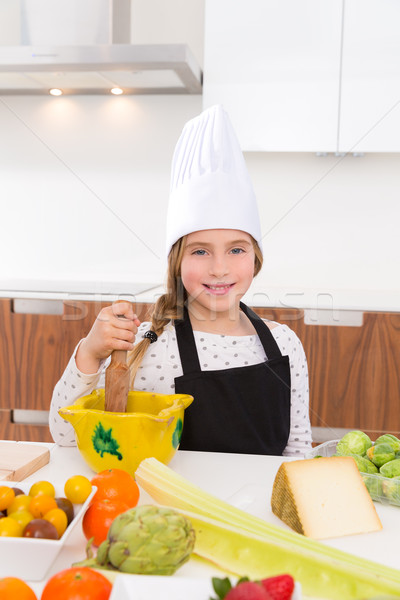 Blond kind girl junior chef on countertop Stock photo © lunamarina