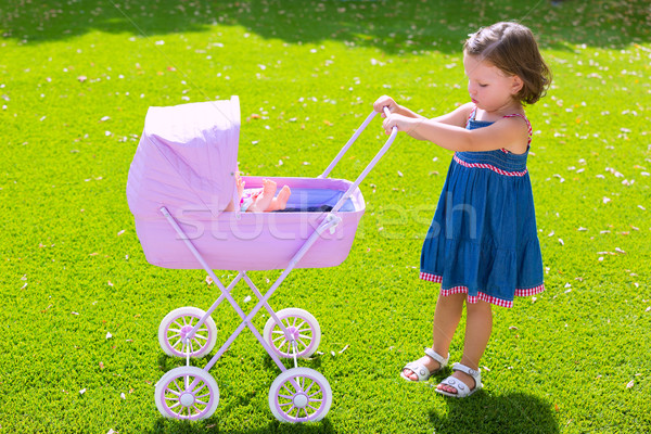 Kisgyerek gyerek lány játszik baba kosár Stock fotó © lunamarina