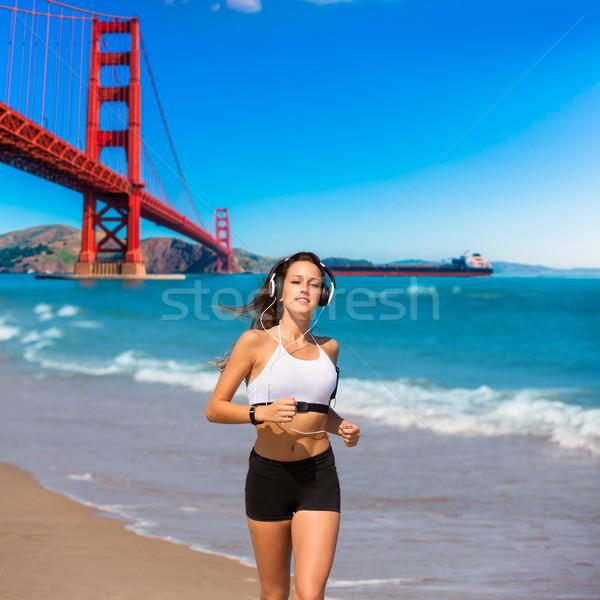 Girl running San Francisco Golden Gate Bridge Stock photo © lunamarina