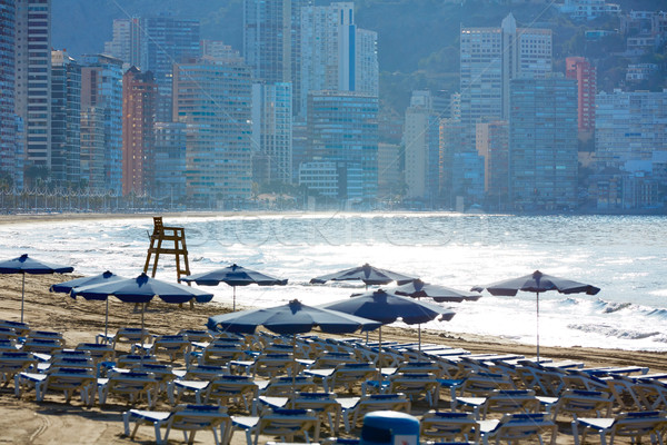 Benidorm sunrise with hammocks and parasol  Stock photo © lunamarina