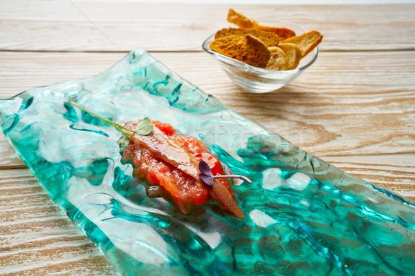 Anchovies on fresh grated tomato tapas Stock photo © lunamarina