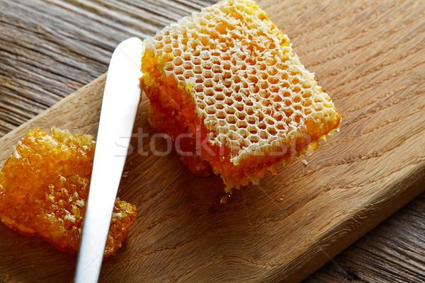 Mel favo de mel pormenor macro textura madeira Foto stock © lunamarina