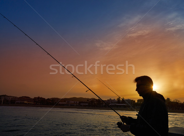 Angler with spinning rod fishing in Mediterranean Stock photo © lunamarina