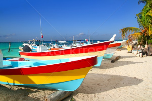 colorful tropical boats beached in sand Isla Mujeres Stock photo © lunamarina