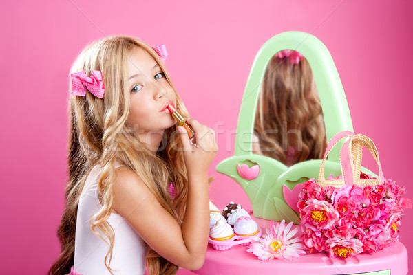 children fashion doll little girl lipstick makeup pink vanity Stock photo © lunamarina