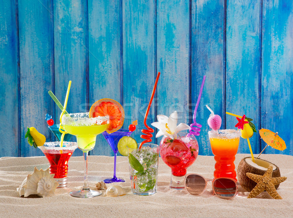 Colorful tropical cocktails at beach on blue wood wall Stock photo © lunamarina