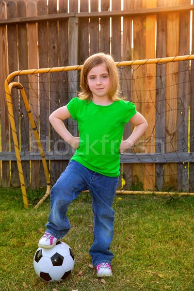 Szőke kislány labdarúgó boldog udvar labda Stock fotó © lunamarina