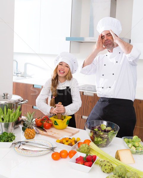 Funny chef master and junior kid girl at cooking school crazy Stock photo © lunamarina