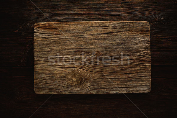 Aged wood cutting board as a copyspace Stock photo © lunamarina
