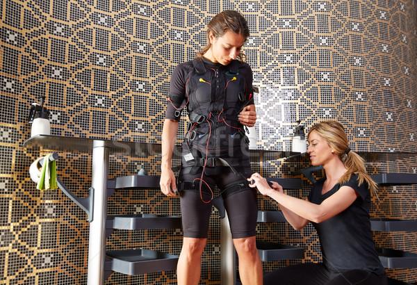 EMS electro stimulation coach suit women  Stock photo © lunamarina