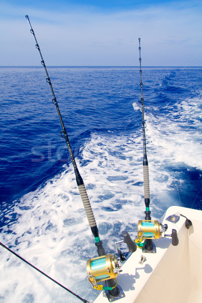 boat fishing trolling in deep blue sea Stock photo © lunamarina