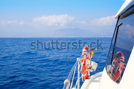 Boat rail with round orange lifesaver blue sea  Stock photo © lunamarina