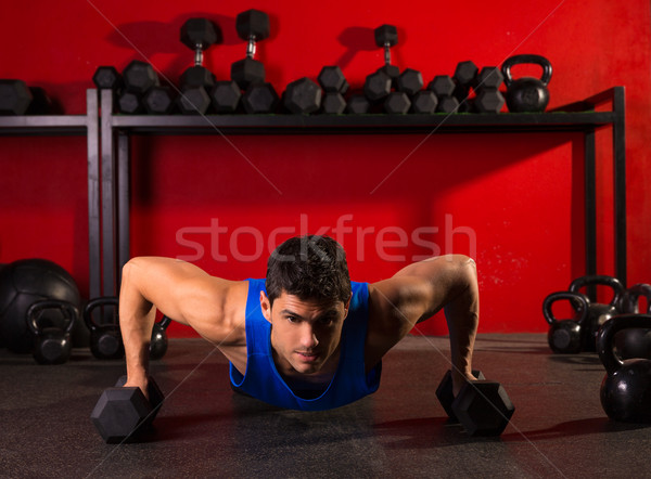 push-up strength man hex dumbbells workout at gym Stock photo © lunamarina