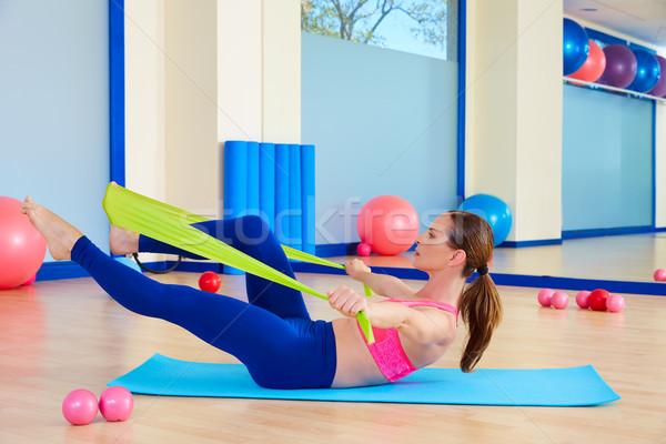 Pilates woman single leg stretch rubber band Stock photo © lunamarina