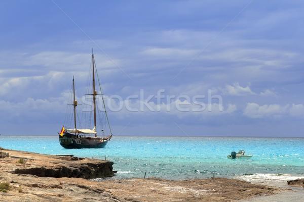 pirates inspired wood sailboat anchored turquoise Stock photo © lunamarina