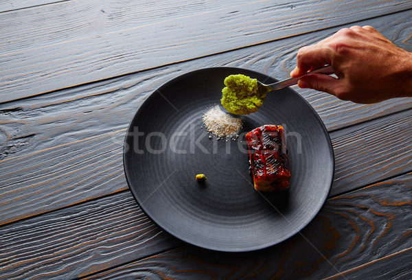 Grilled smoked eel on black plate Stock photo © lunamarina
