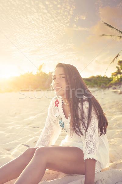 Latin beautiful girl sunset in Caribbean beach Stock photo © lunamarina