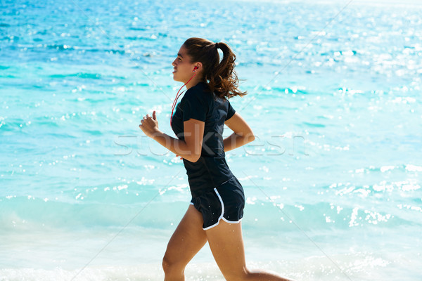 Latin girl running in caribbean shore beach Stock photo © lunamarina