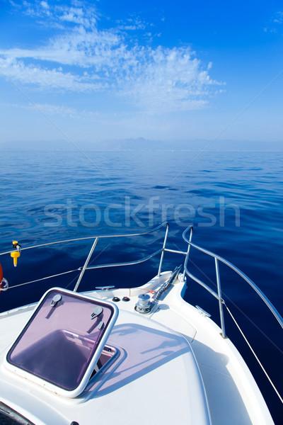 Blue sea boat sailing with open bow porthole Stock photo © lunamarina