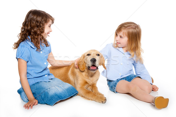 kid girls with Golden retriever puppy isolated Stock photo © lunamarina
