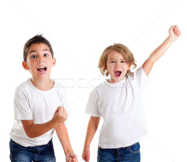 excited children kids happy screaming and winner gesture Stock photo © lunamarina