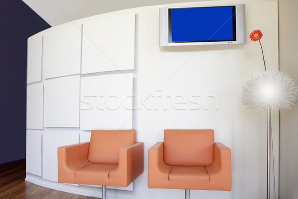 Modern office lobby with orange gerbera flower Stock photo © lunamarina