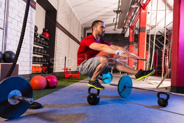 Kettlebell férfi pisztoly egyensúly tornaterem edzés Stock fotó © lunamarina