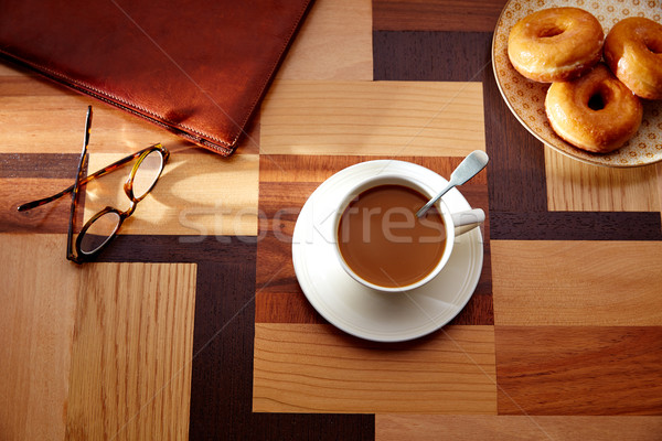 Coffee cup and dona with glasses on table retro Stock photo © lunamarina