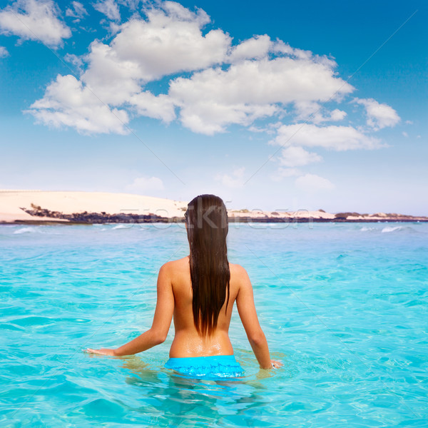 Stock photo: Girl on the beach Fuerteventura at Canary Islands