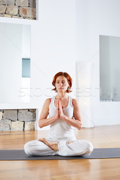 Yoga Lotus pose meditation in wooden floor Stock photo © lunamarina