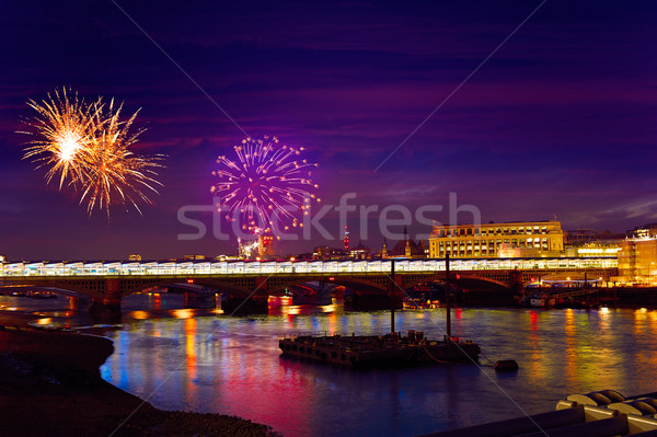 London skyline sunset fireworks on Thames Stock photo © lunamarina