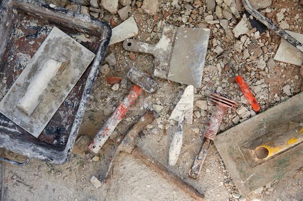 Mason tools on debris background Stock photo © lunamarina