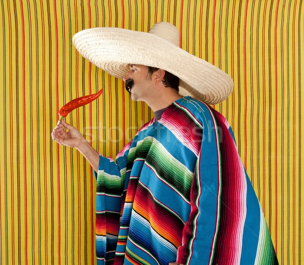Chili hot pepper Mexican man typical poncho serape Stock photo © lunamarina
