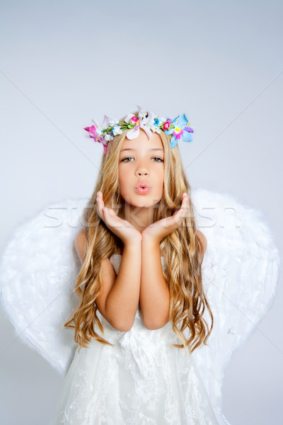 Angel little girl blowing expression with wings Stock photo © lunamarina