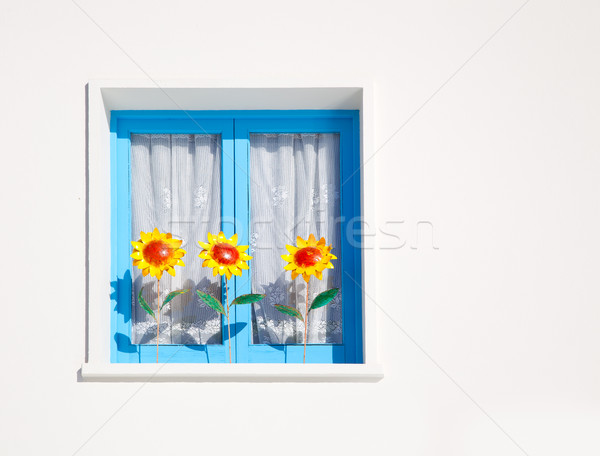 Balearic blue window with three sunflowers Stock photo © lunamarina