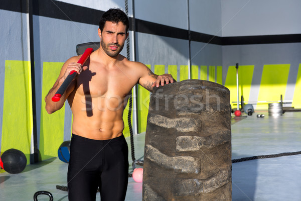 Crossfit sledge hammer man at gym relaxed Stock photo © lunamarina